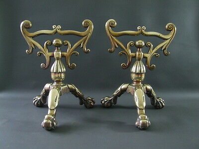 Antique or vintage pair of ornate brass fire dogs on claw feet - fire iron rests