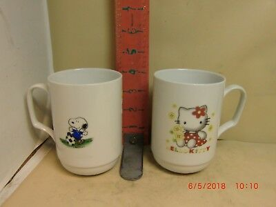 Snoopy With A Soccer Ball Mugs On One Side , Hello Kitty On The Other