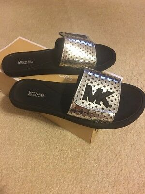 bbbed997360f Michael Kors MK SLIDE Flat Sandals Lasered Mini MK Logo PVC White   Navy  Size 8