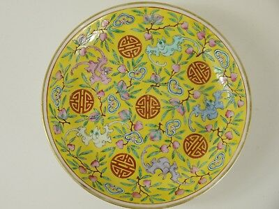 Chinese yellow bowl with peaches, bats and shou.  Four character Qianlong mark