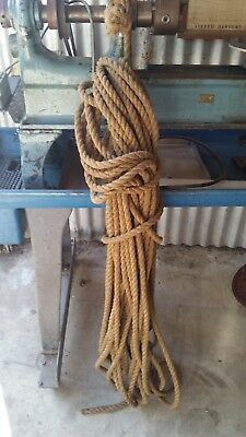 Old natural fibre rope over 40m in length. Comes with an old metal pulley!