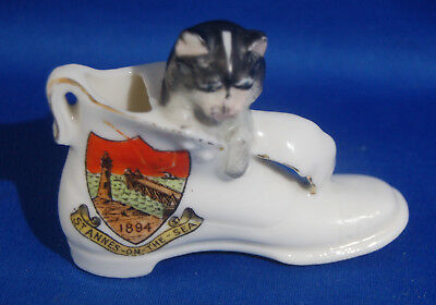 An antique Crested porcelain cat in a boot figure, dated 1894, St. Anne's on Sea