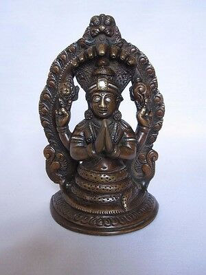 An old look solid brass sitting NAG-KANYA snake lady hindu traditional statue