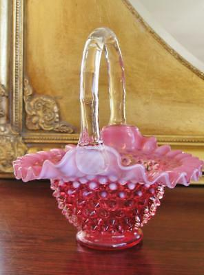 Fenton Cranberry hobnail glass basket with opalescent ruffle rim.