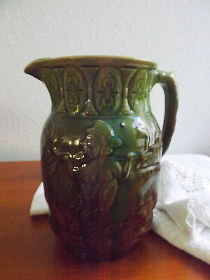 Antique Yellow Ware Pitcher Embossed Satyr Bacchus Jug  Green & Brown Glaze