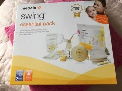 MEDELA electric swing breast pump and extra Medela quick clean microwave bags