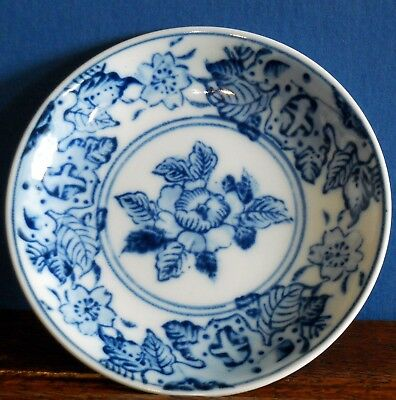 A small antique / vintage hand decorated blue and white Japanese porcelain plate
