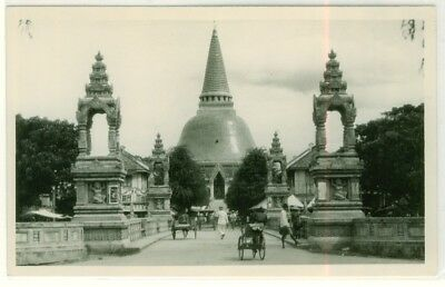 Postcard showing entrance to Buddhist temple.
