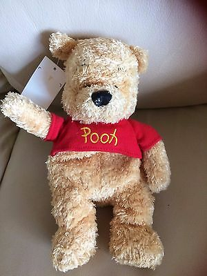 """New with tag,part  beanie Winnie the Pooh plush toy approx 8"""" tall, in a red top"""