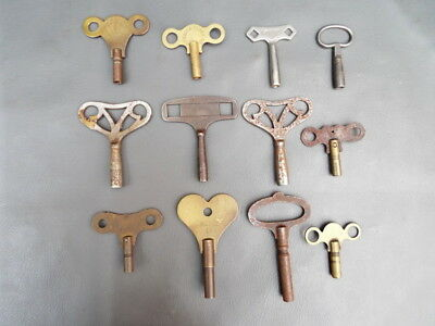 Job lot of 12 vintage mantel clock keys - spares parts