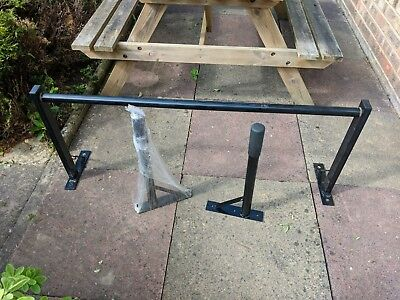 Wall mounted dip bars and wall mounted pull up bar. Gym quality
