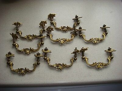 8 ornate vintage brass and metal draw or door handles complete