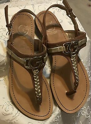 f9ef5a1251da G By Guess Women s Lindsey Gold Bling Flat Sandals Tan T-Strap Thong Size 7M