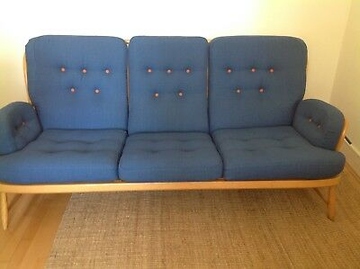 Ercol 3 seater Jubilee sofa professionally recovered in stunning blue fabric