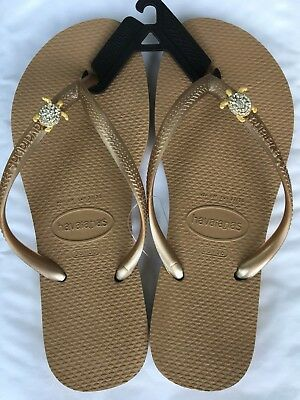 3a2d0984d470 HAVAIANAS SLIM ROSE Gold flip-flops with 2 Gold Crystal Tortoise Charms £ 22.99 - £22.99