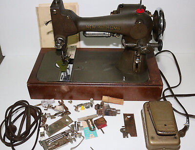 vintage New Home model 8f sewing machine complete w/ manual, pedal, attachments