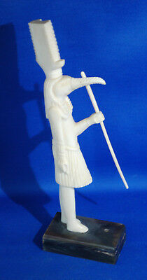 An antique Victorian era carved animal bone Eqyptian figure, deity Thoth