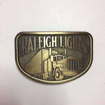 Vintage JJ Raleigh Lights Belt Buckle With Truck Design