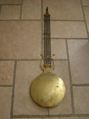 Old lyre pendulum of Comtoise diameter 24,5cm