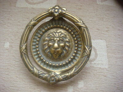 large brass door knocker with lion face