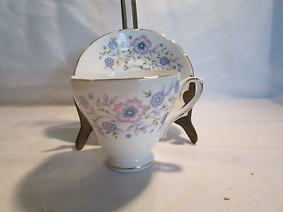 Blue Blossoms Fine Bone China Made in England for Avon 1974 Cup And Saucer