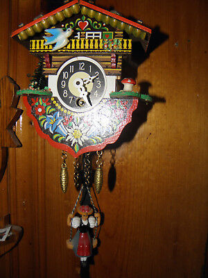 Novelty German Chalet Clock with Girl on Swing very cute!
