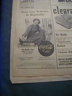 1949 coca cola newspaper ad shows a wooden case of coke and the price