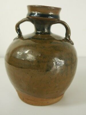 A Chinese Henan / Cizhou type brown glazed, two handled jar.  Northern Song dyn.