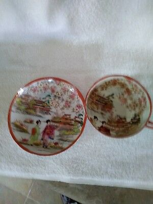 Antique hand painted Japanese scene tea and saucer set