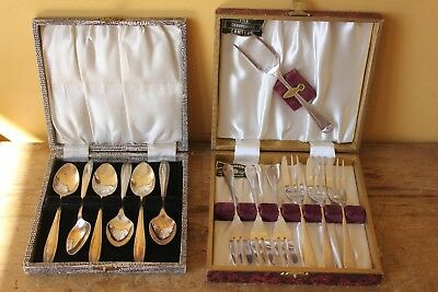 Two boxes of vintage silver plated cutlery.  Spoons & forks.