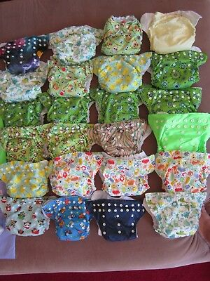 24 snap adjustable cloth diapers, assorted prints,liners,wetbags diaper stacker
