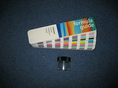 Pantone Color Formula Guide Coated and Uncoated with a Lupe
