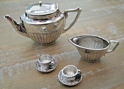 A Collectable English Hallmarked Sterling Silver Miniature Tea Set / Dolls House