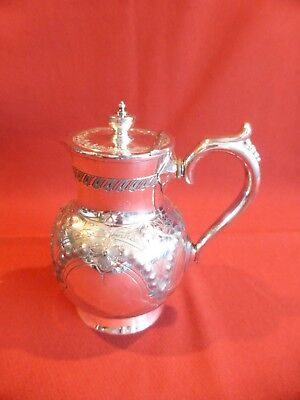 Antique late 19th century silver plated engraved & decorated hot water jug