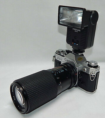 VERY NICE VINTAGE CANON AE-1 35mm CAMERA W/200mm ZOOM LENS AND FLASH
