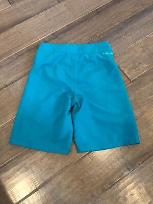 Youth Boys size 22 Under Armour Swim trunks in Jade color with bright green.