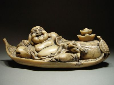 VINTAGE CHINESE HAND-CARVED LAUGHING 'HOTEI' FIGURINE. CIRCA 1900's