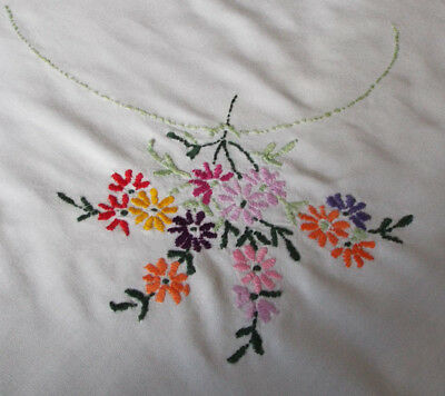 Pretty old/vintage tablecloth hand embroidered with flower sprays to the corners