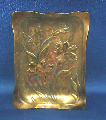 An antique Art Nouveau Victorian brass trinket tray with repousse Iris design
