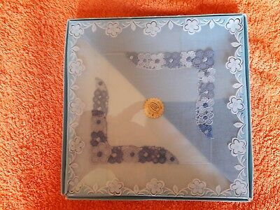 Two embroidered cotton handkerchiefs in blue