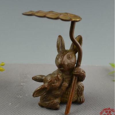Chinese bronze hand-carved vivid bunny in the rain