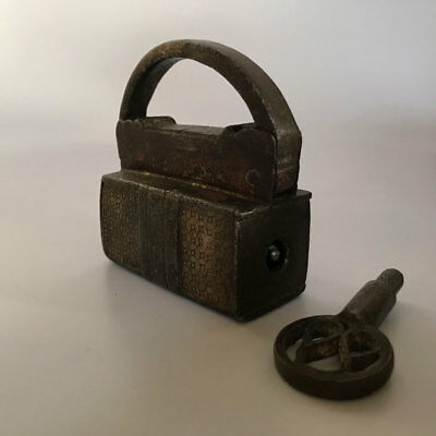 An old or antique Iron screw type padlock lock with key very early and primitive