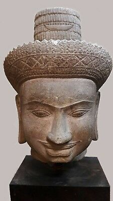 A SANDSTONE HEAD OF THE HINDU GOD SHIVA. ANGKOR 'BAKHENG' STYLE. Possibly 13th C