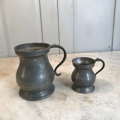 Couple of antique pewter measures