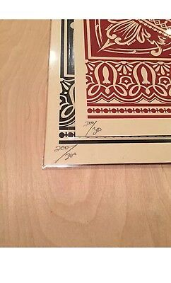 Pair of Shepard fairey signed and Numbered X/300 Presidential seal print 2007