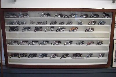 Lot of 45 Harley Davidson Die Cast Models w/ Wall mounting display case.