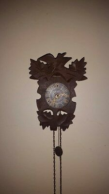 antique wall clock made in west Germany bird, pine cone, chains
