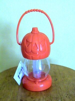 Orange Plastic Halloween Lantern.  Uses 3 Aa Batteries.