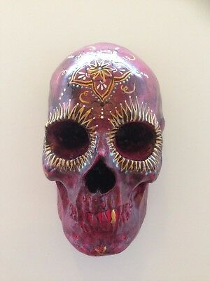 Hand cast Day of the Dead style wall hanging skull