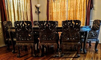 Antique Chinese hand-carved dining room table with 8 hand carved chairs